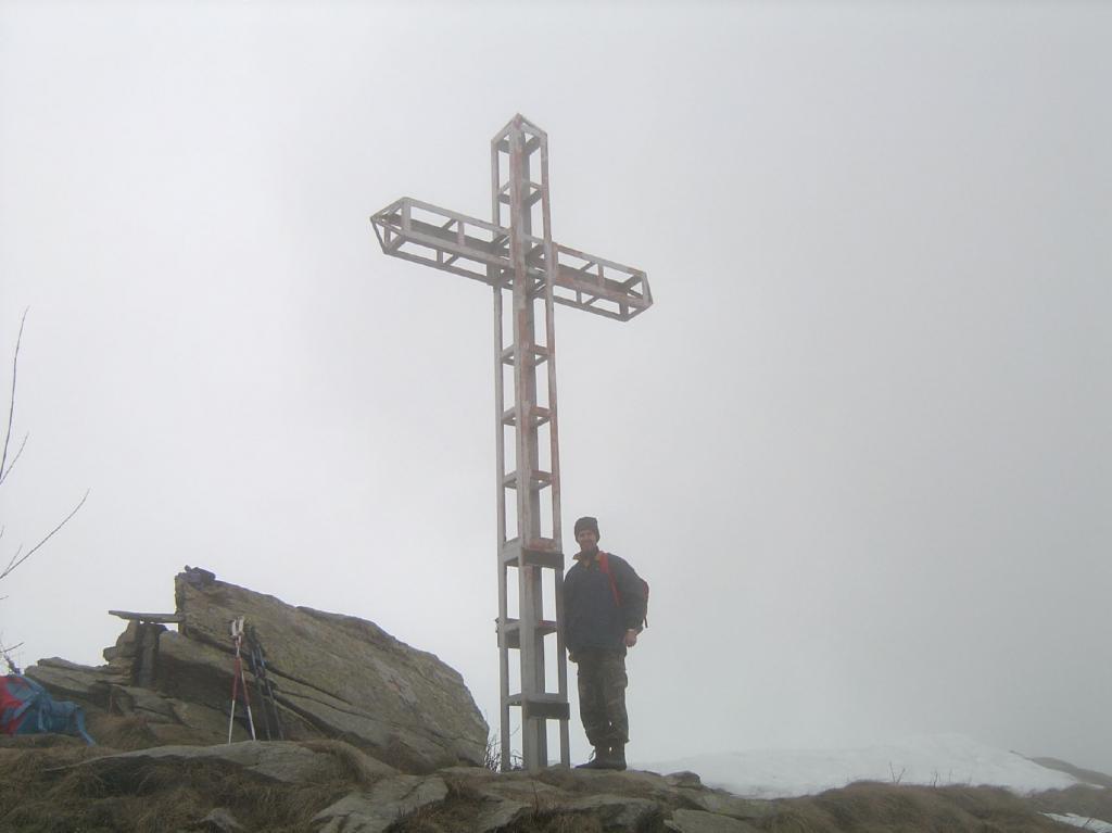 Paolo alla cima della croce