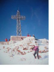 Michele con dietro la Croce di vetta