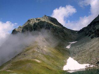 La valletta da percorrere a Est del lago Perrin. A sx la Gran Cima.