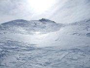 La discesa e il sole che si specchia sulla neve