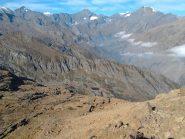 vista dal colle del Monte Rosso (2590). in basso il lago Casias, sullo sfondo Bessanese e Ciamarella