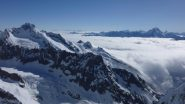 Vista sul Mont Dolent e nuvole sulla val Ferret svizzera.