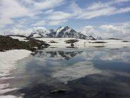 Il Tresero riflesso sul lago della Manzina