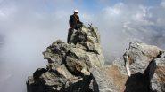 Davide in cima al torrioncino sommitale con la piccola croce metallica di vetta (17-8-2013)