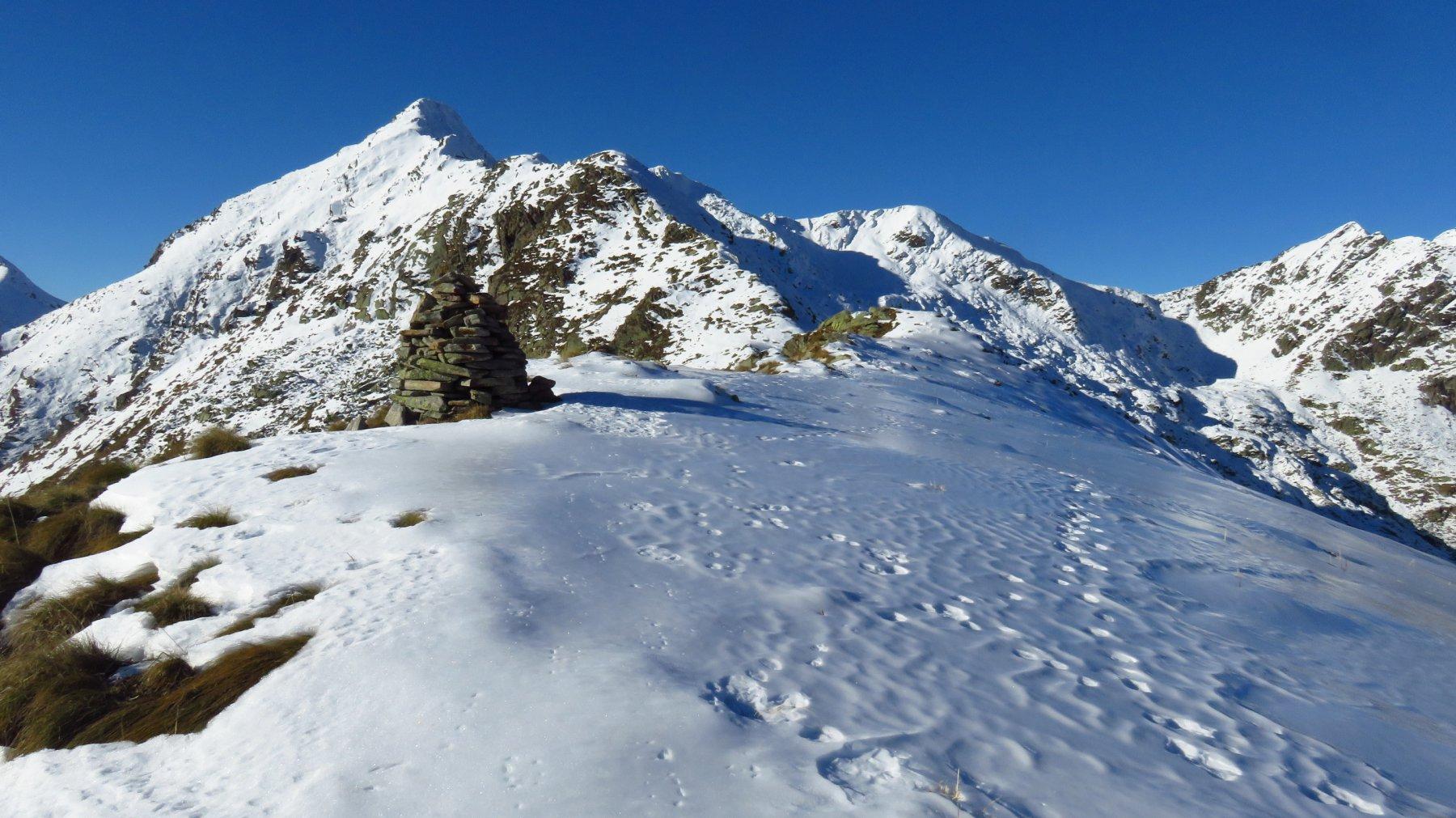 Ometto di Rocce Bianche, con neve trasformata in lastra di ghiaccio vivo