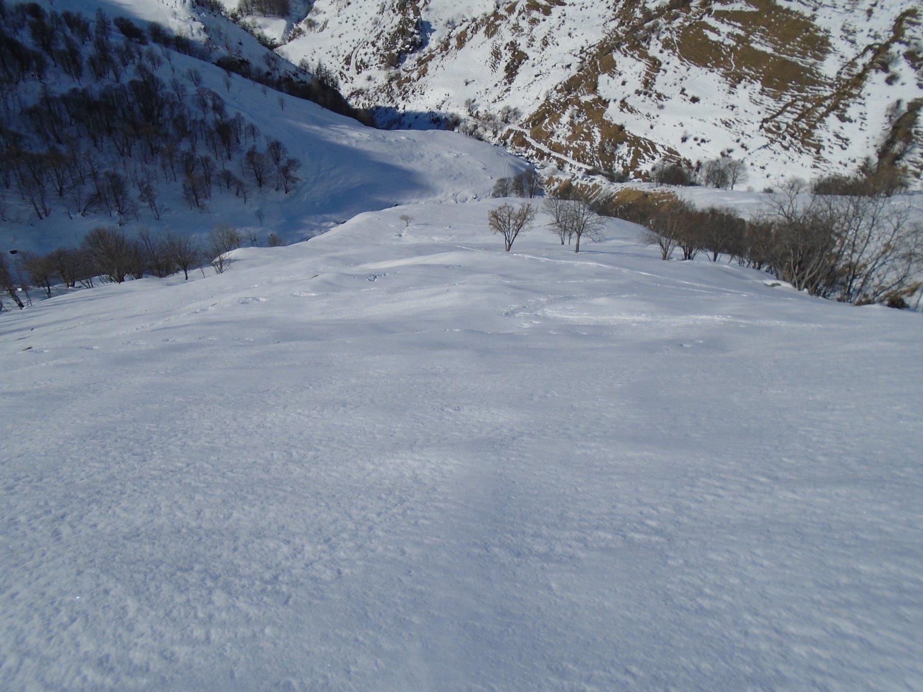 Parte bassa del pendio di salita/discesa, su neve non ancora smollata