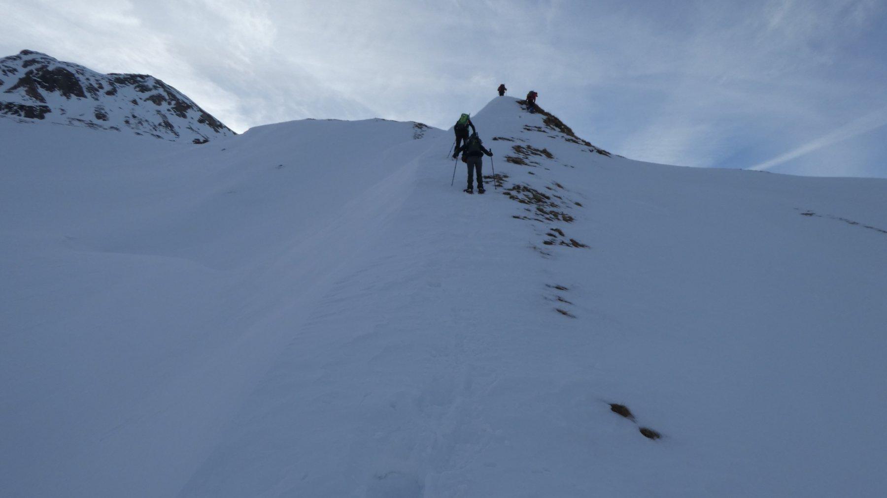 salendo i pendii nevosi verso il Passo di Busin