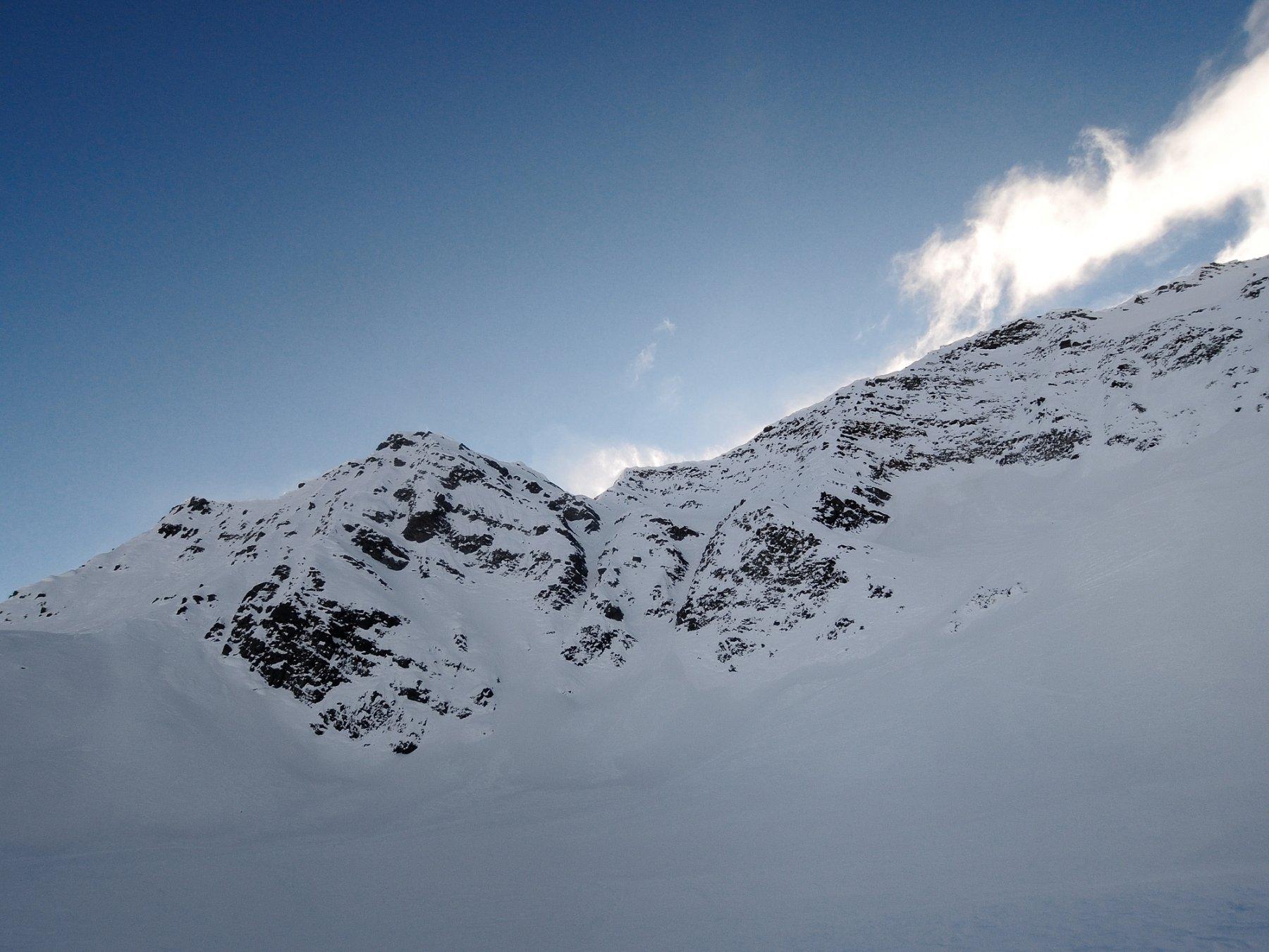 La cima con il vento che ci attende in cresta
