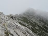 La cima emerge appena dalle nuvole, vista dal versante Onsernone
