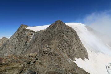 la comoda cresta rocciosa che porta all'ingresso del canale che scende al colle di Faceballa